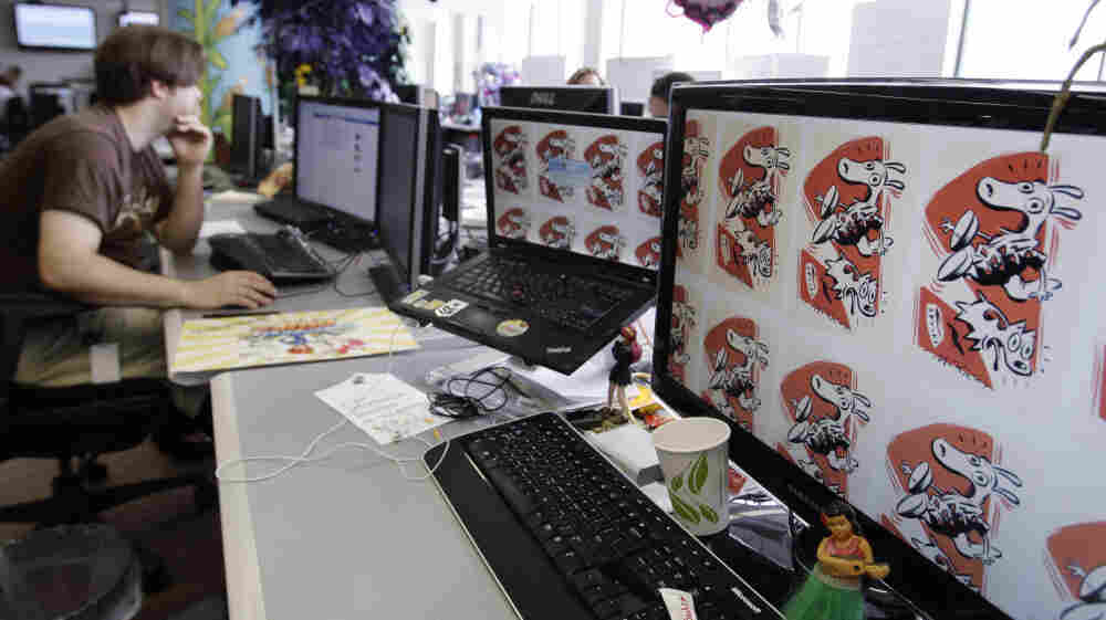 "An employee works on the Zynga game ""FarmVille"" at Zynga headquarters in San Francisco."