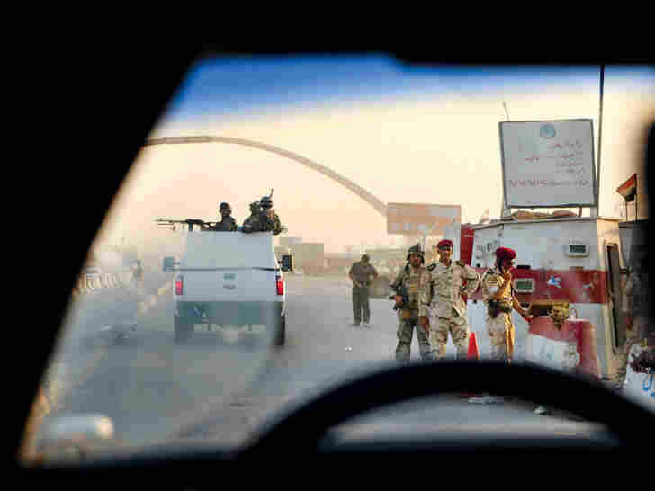 Baghdad's traffic, choked by hundreds of checkpoints, slows to a crawl while security forces inspect vehicles for weapons and explosives.