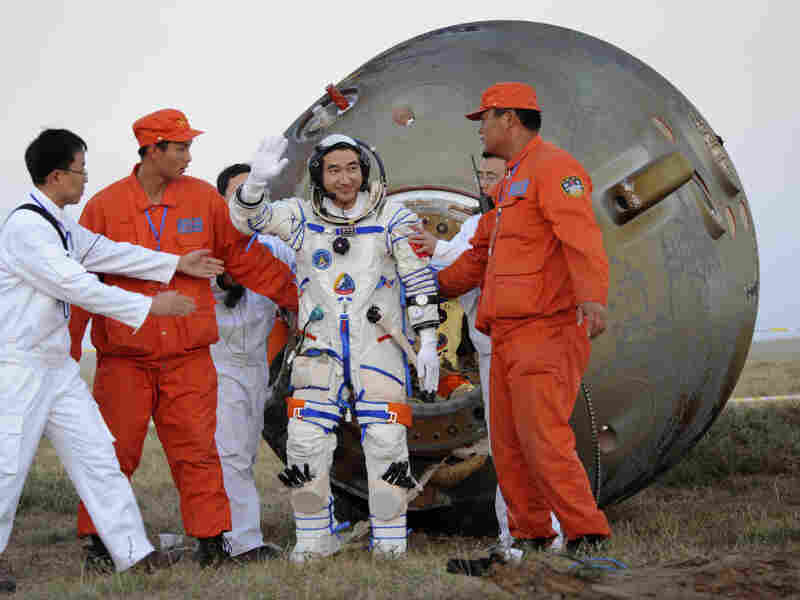 In this photo released by China's Xinhua News Agency, taikonaut Zhai Zhigang waves after getting out of Shenzhou-7 re-entry module after its landing in 2008. Zhai conducted the country's first-ever spacewalk during the mission.