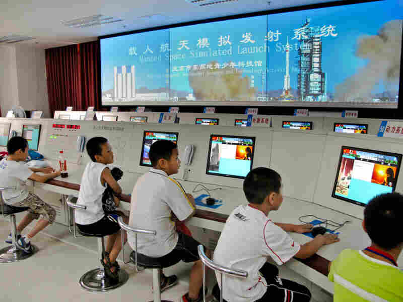 Pint-sized would-be astronauts in a miniature simulated rocket launch center at  a brand new space education center for kids in southern  Beijing.