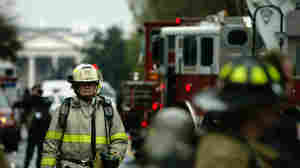 Firefighters in the nation's capital (shown near the White House in 2004) have some fairly sophisticated communication devices. But those devices use the same commercial networks as D.C.-area residents. In an emergency, those networks can get crowded.