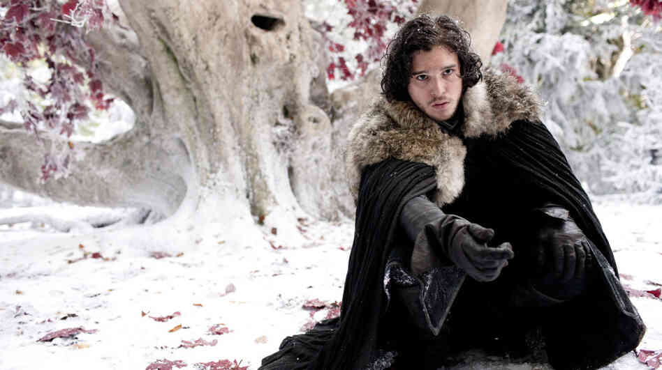 Kit Harington plays Jon Snow in HBO's adaptation of Game of Thrones. In George R.R. Martin's latest novel, A Dance with Dragons, Snow has just been elected Lord Commander of the Night's Watch.