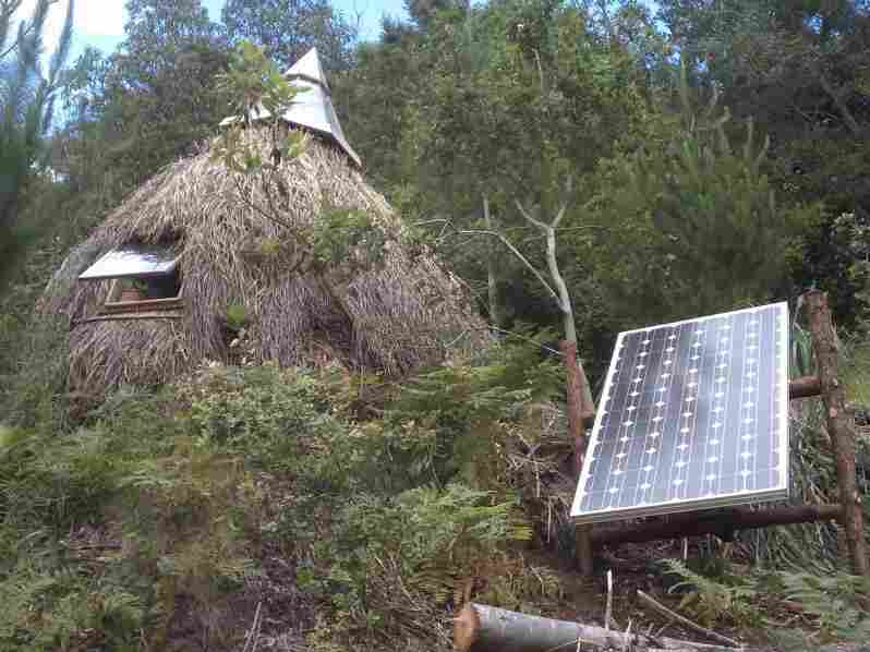 Rabinovitch's grass hut combines a primitive design with more advanced  solar technology. Trout Gulch's 18 residents live in a variety of tiny  homes, huts and tree houses.