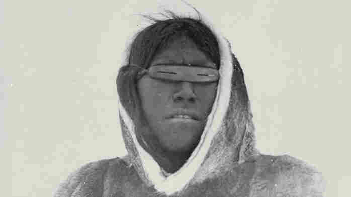 Anavik wearing snow goggles made of wood at Banks Peninsula, Bathurst Inlet, Northwest Territories (Nunavut), Canada, in May of 1916.