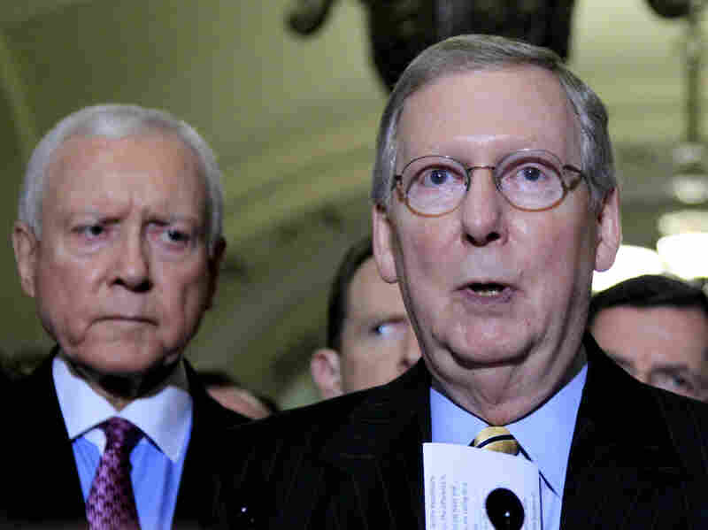 Republican Senator Orrin Hatch, Utah, looks on as Senate Minority Leader Mitch McConnell speaks to reporters on Capitol Hill about balancing the budget.