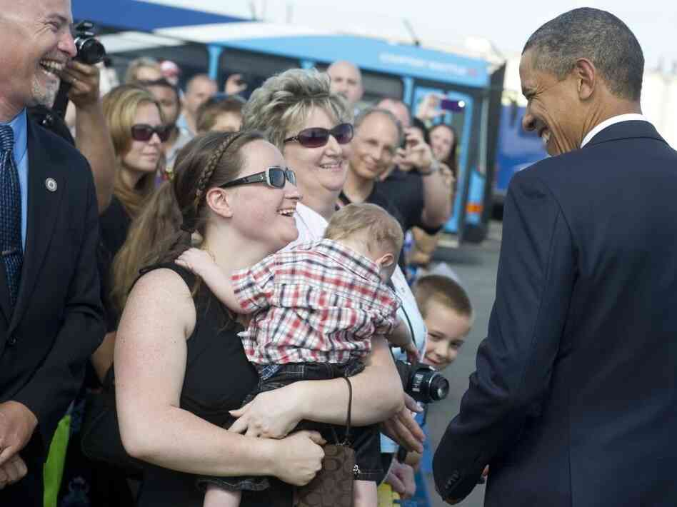 President Obama greets wellwishers as he heads to two  campaign fundraisers in Philadelphia, Pa., June 30, 2011.