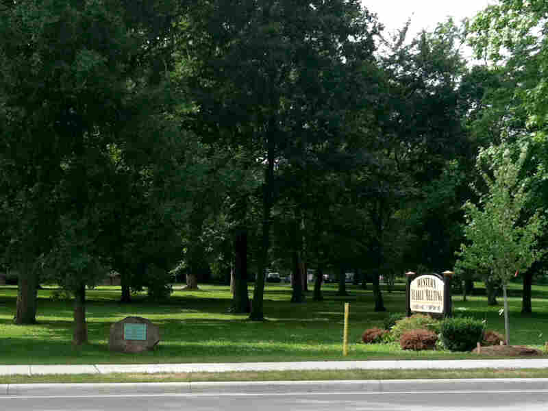 The plaque is located along U.S. 40, but few motorists see it tucked away in a grove of trees.