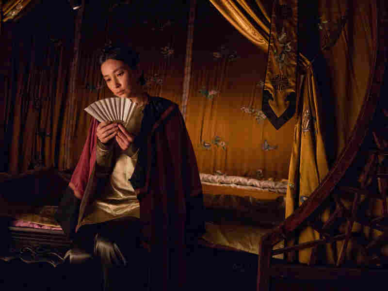 The characters Lily (shown) and Snow Flower exchange secret messages written between the folds of a fan.