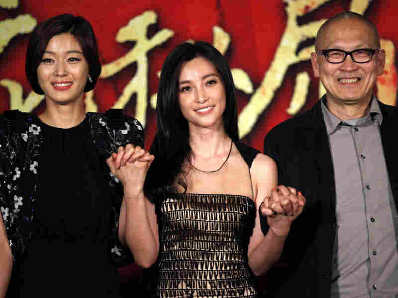 South Korean actress Gianna Jun, left, Chinese actress Li Bingbing, center, and Chinese American director Wayne Wang, right, attend the 14th Shanghai International Film Festival Sunday in Shanghai, China.