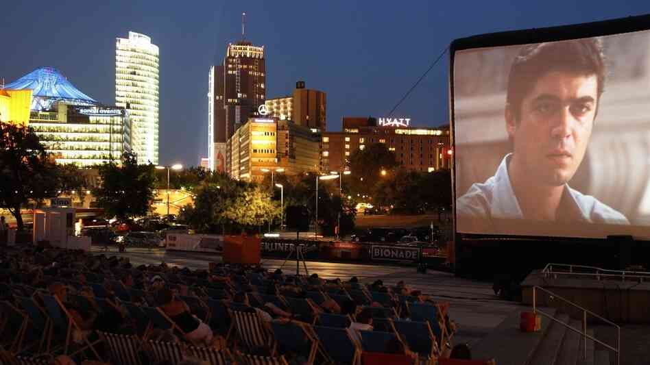 The audience watches a screening of the film 'Männer al Dente' at the open air cinema Kulturforum Potsdamer Platz on July 12, 2010 in Berlin.