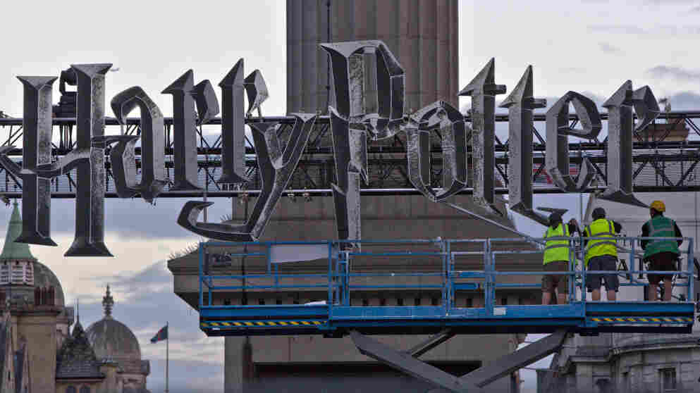 "Workmen erect a large ""Harry Potter"" sign before the London premiere of the last film in the Harry Potter series."