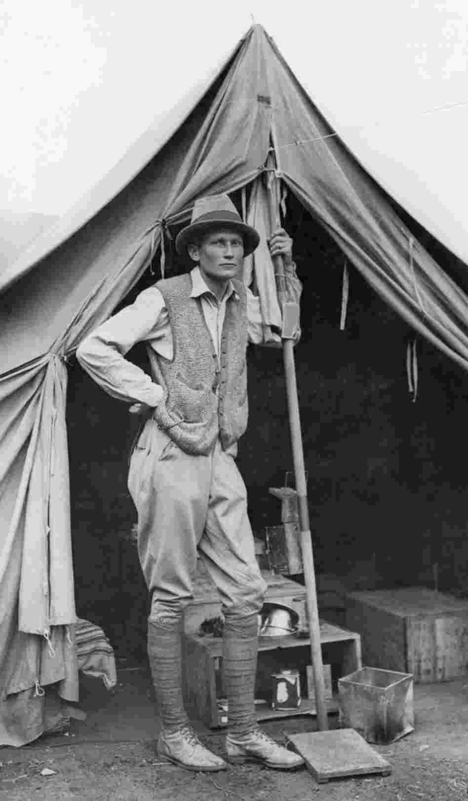Hiram Bingham stands outside his tent during the 1912 expedition.