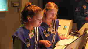 "Seventh-graders Sophie  Maloro (left) and Unity Bowling ""fly"" a mission to Mars, part of a summer program at the MathScience  Innovation Center in Richmond, Va."