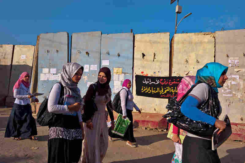 Young women head to class at the University of Baghdad, passing blast walls plastered with political posters. More than half the 70,000 students are female. The school closed briefly in 2006, after a rash of killings and kidnappings targeted academics.