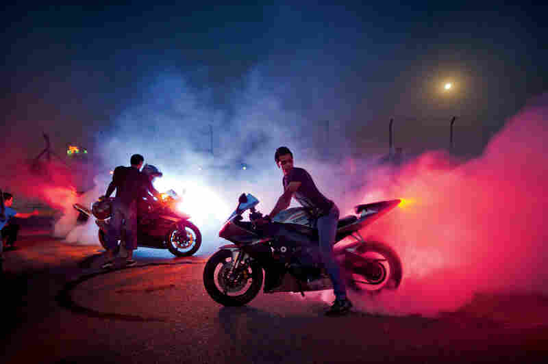 Bikers rev their engines in Al Jadriyah Lake Park.