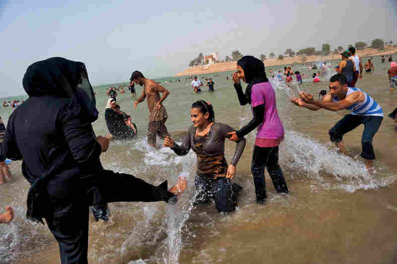 Iraqis escape blistering city temperatures in Habbaniyah Lake, 50 miles west of Baghdad. Once a top tourist and honeymoon destination, the Habbaniyah area filled with Sunni refugees fleeing militia violence after the invasion. Tourists have begun trickling back.