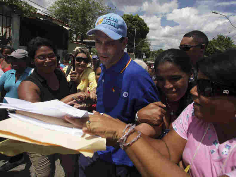 Gov. Henrique Capriles, third from right, receives written petitions from residents during a rally in Ocumare Del Tuy, Venezuela. Capriles, who is the governor of Miranda state in Venezuela, was statistically tied with President Hugo Chavez in a recent poll for next year's presidential election.