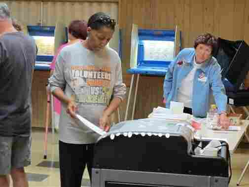 A voter casts a ballot in a Democratic primary on July 12 in Wisconsin, one of seven states to enact voter ID laws this year.