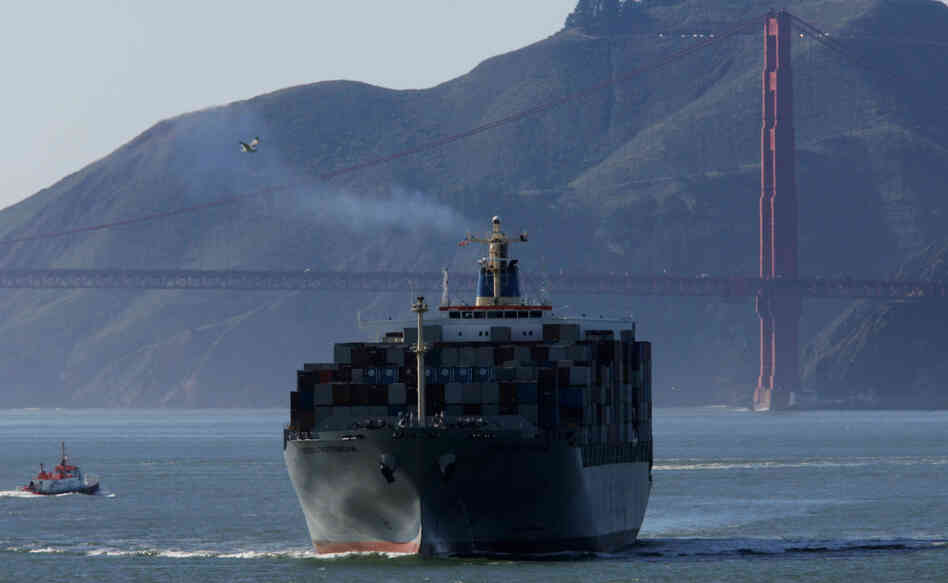 One of the fastest-growing sources of air pollution, cargo ships have faced growing pressure from critics to curtail emissions. Here, a cargo ship passes the Golden Gate Bridge, as seen from Treasure Island, Calif.