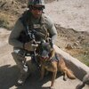 "Marine Cpl. Daniel Cornier and his colleague, Chaak, in Afghanistan. ""Pretty much trust him with my life,"" Cornier says."