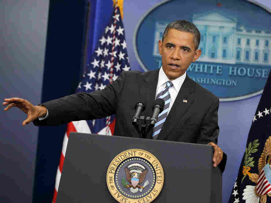 President Obama holds a news conference in the White House briefing room Friday.
