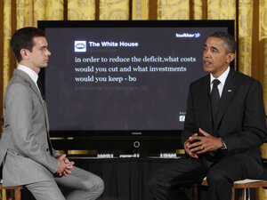 "President Barack Obama sits with Twitter co-founder and Executive Chairman Jack Dorsey in front of a screen displaying the question he tweeted during a ""Twitter Town Hall"" in the East Room of the White House in Washington, Wednesday, July 6, 2011."