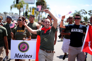 """Marines and other military personnel march in San Diego's gay pride parade on Saturday. About 200 active-duty troops and veterans from every branch of the military participated for the first time in the march since Congress voted to repeal """"don't ask don't tell."""""""