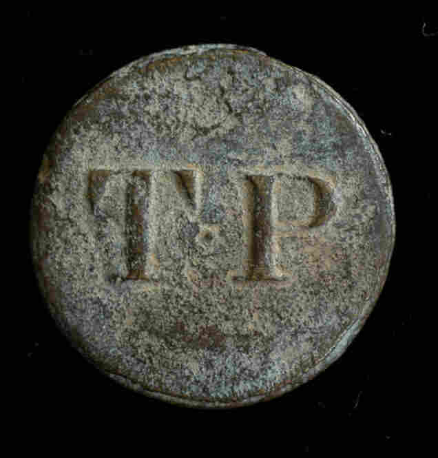 Thomas H. Porter Slave Buttons, c. 1820Thomas H. Porter, a slave trader based in Barbados, sold slaves along the coasts of Alabama, Louisiana, Mississippi, Georgia and the Carolinas, circa 1815-1830. He attached these buttons to the enslaved person's clothing during auctions.