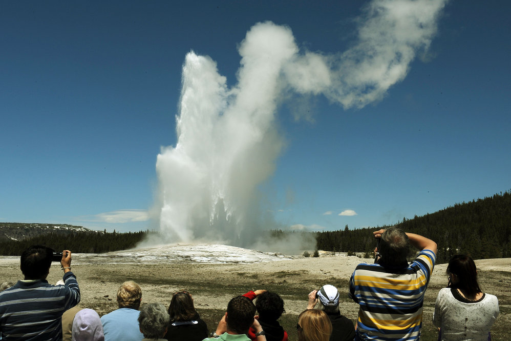 Tourists watch the Old Faithful geyser, which erupts on average every 90 minutes.