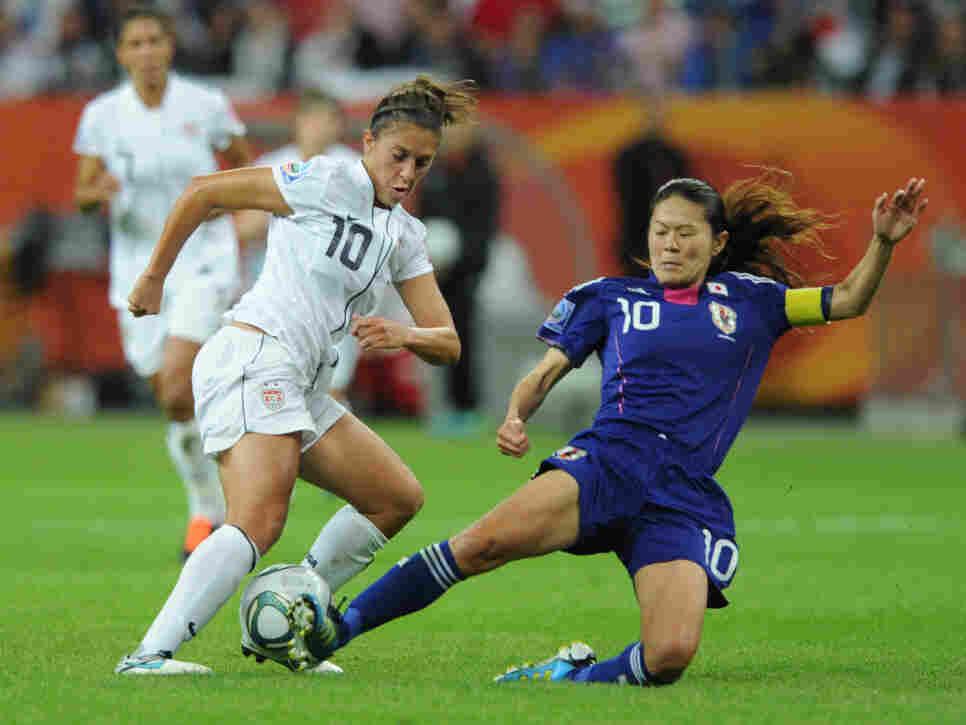 Japan's midfielder Homare Sawa (R) and USA's midfielder Carli Lloyd vie for the ball during the FIFA Women's Football World Cup final match in Frankfurt.