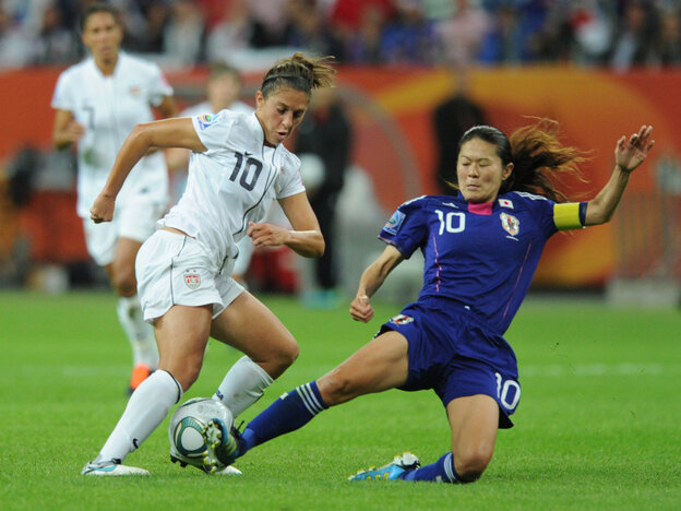 Japan's midfielder Homare Sawa (R) and USA's midfielder Carli Lloyd vie for the ball during the FIFA Women's Football World Cup final match in Frankfurt.