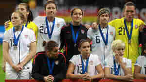Members of the U.S. women's national team look on after losing the FIFA Women's World Cup Final against Japan. The Americans lost on penalty kicks after overtime expired with the teams tied, 2-2.