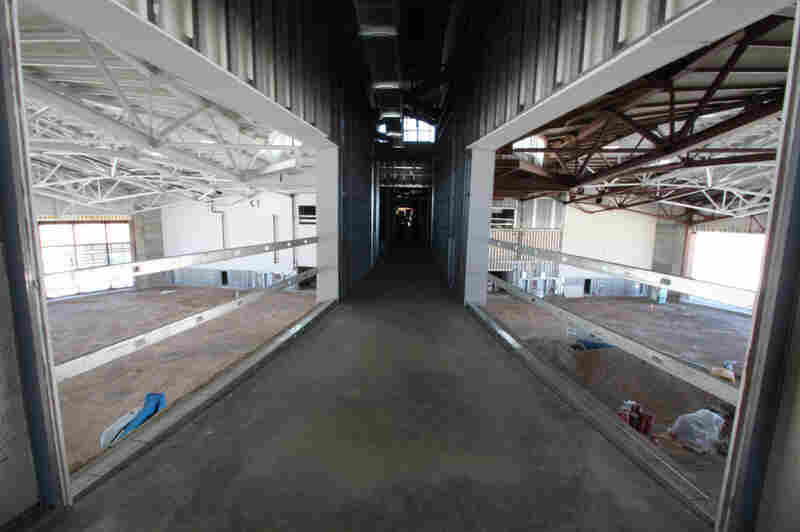 Space tourists will be able to gawk from this walkway at the hangar where Virgin Galactic will store its spacecraft.