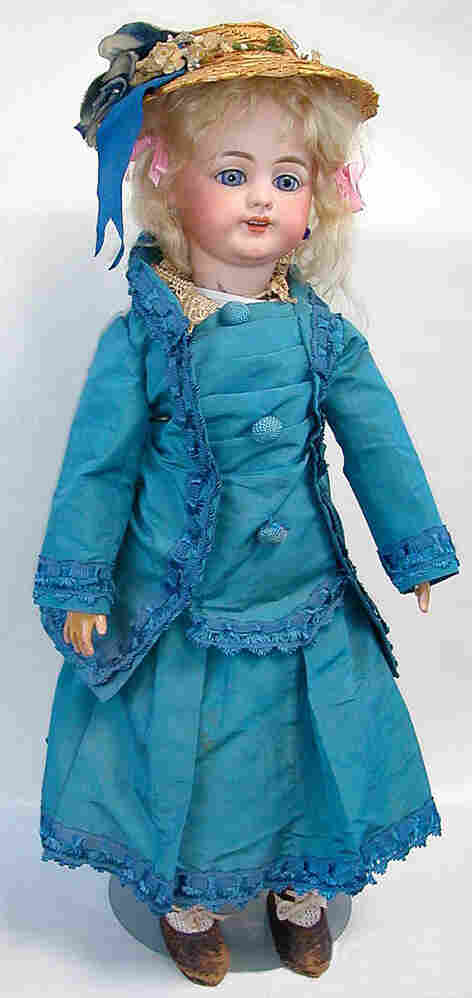 The cylinder was designed to fit a tiny hand-cranked phonograph inside this hollow-bodied doll.  The design was not a success.