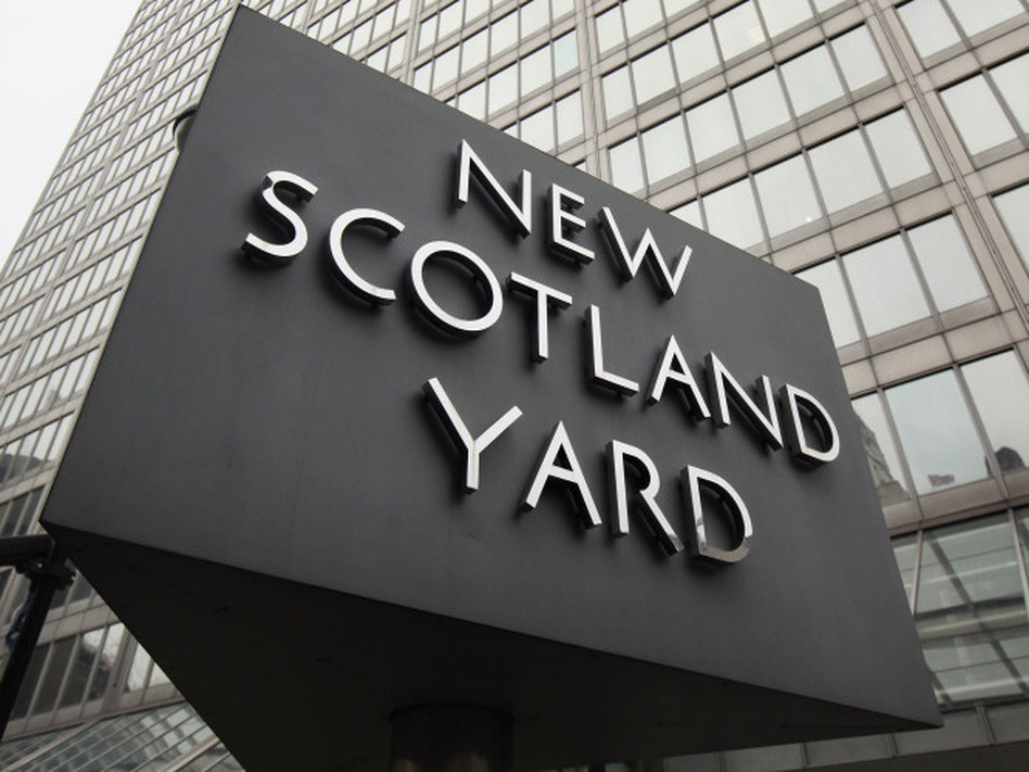 Britain's phone-hacking scandal has put the spotlight on the relationship between News Corp. and the police. London's two top police officers have resigned amid the scandal. (Getty Images)
