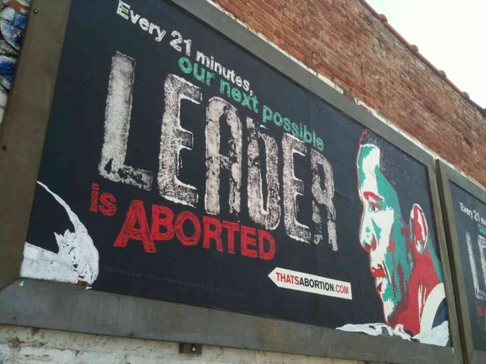 An anti-abortion billboard with President Barack Obama's image is shown by a vacant lot in the Englewood neighborhood of Chicago's South Side Saturday, April 23, 2011. The billboard is from a Texas anti-abortion group, not the Radiance Foundation, whose co-founder appeared in this interview with NPR.