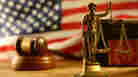 Does the American justice system examine and punish street crimes and corporate crimes equally?