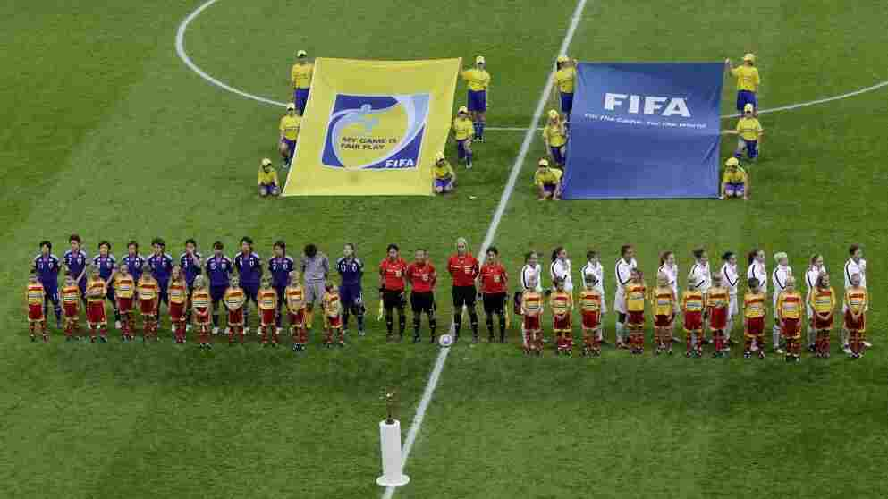 Japan and US teams stand for the singing of the national anthems prior to the final match at last night's Women's Soccer World Cup. Japan beat the US in a final penalty shootout round.