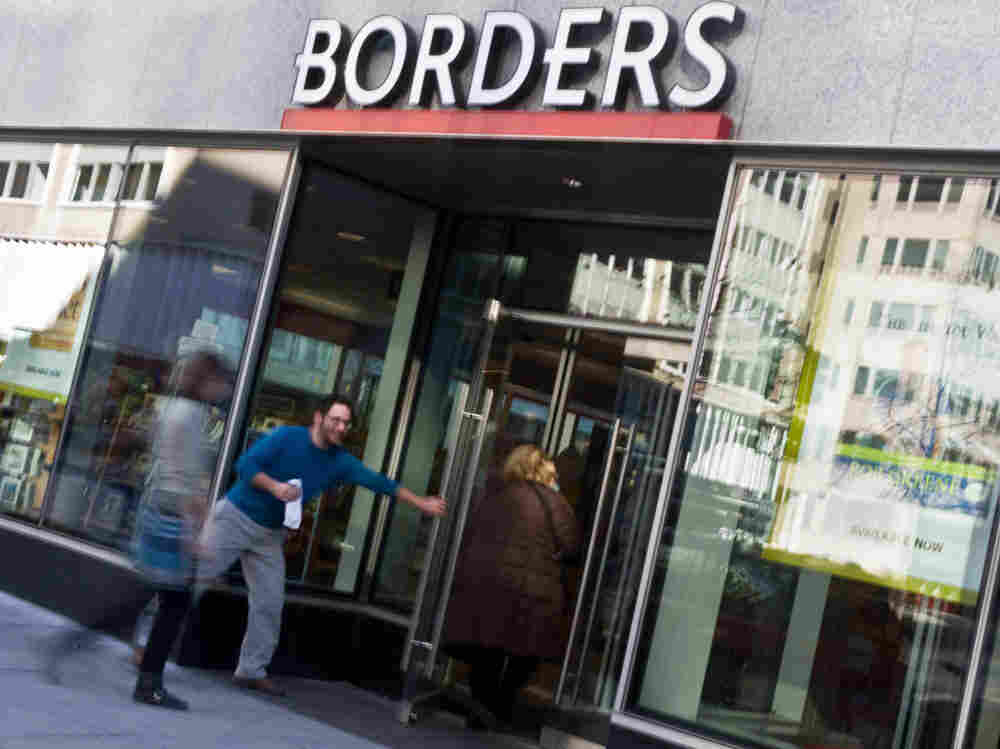 People enter a  Borders bookstore in Washington, D.C.