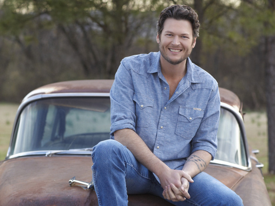 "Blake Shelton has just scored his fourth consecutive No. 1 county hit with ""Honey Bee,"" from <em>Red River Blue</em>."