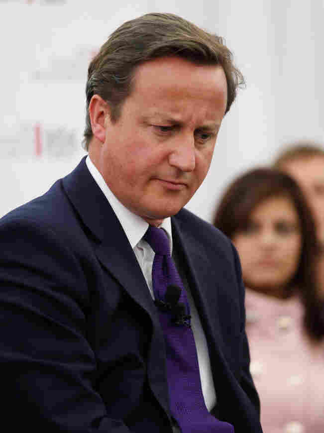 British Prime Minister David Cameron attends a question and answer session Sunday at the Johannesburg Stock Exchange. Cameron is cutting short a trip to Africa to attend an emergency session of Parliament, being held to discuss the broadening British phone-hacking scandal.