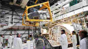 A large section of Discovery's nose, called the forward reaction control system, which helped steer the shuttle while in orbit, was removed in March. The spacecraft will be cleaned and detoxified before being put on display in museums.