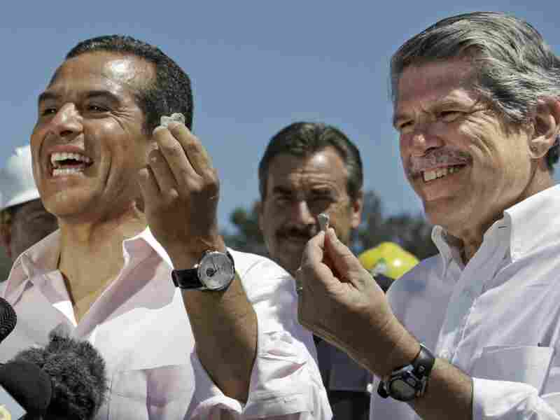 Los  Angeles Mayor Antonio Villaraigosa (left) and Los Angeles County  Supervisor Zev Yaroslavsky hold souvenir concrete chips as they  celebrate the demolition of two lanes of the Mulholland Drive bridge  over I-405 ahead of schedule Sunday.