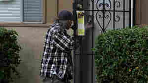 The Real Deal: Locksmiths are trying to find ways to warn the public against scam artists. In this file photo, a locksmith picks the lock of a foreclosed home in California.