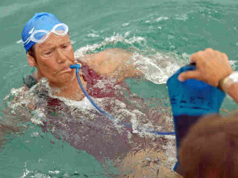 Nyad stops for hydration and feeding breaks every hour and a half. Her team estimates she will take 40 breaks of five minutes each during the swim.  Here, she takes in a concoction of electrolytes and fluids. Each break will increase her time in the water and make it more difficult for boat drivers and navigators to maintain a strict course while fighting currents.