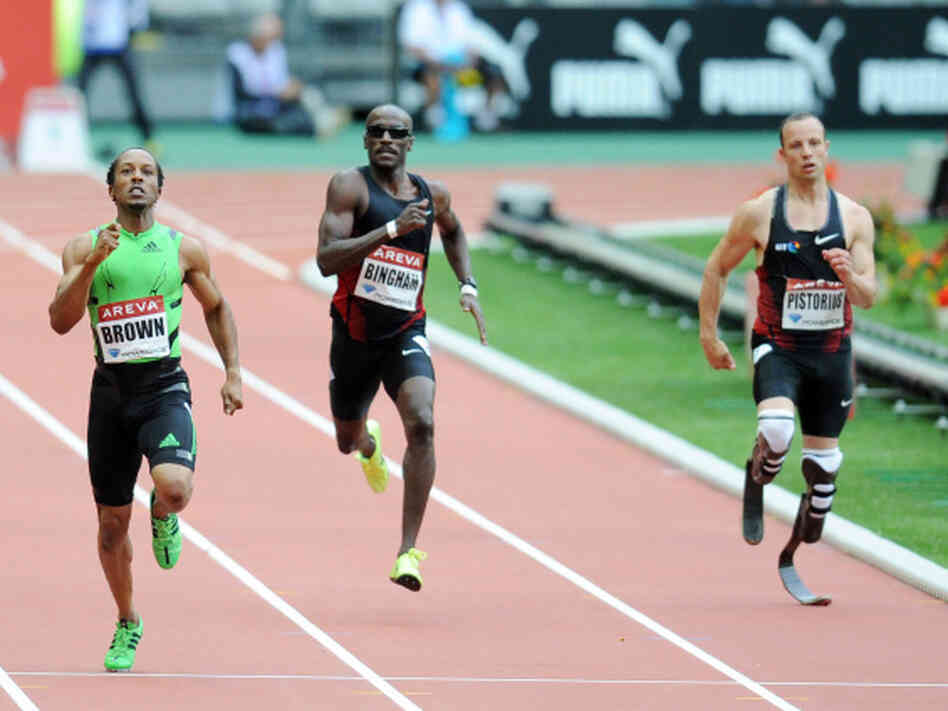 South African runner Oscar Pistorius, right, runs in the 400 meter race in France, July 8, 2011. His time in a race in Italy Tuesday was good enough to send him to the World Championships.