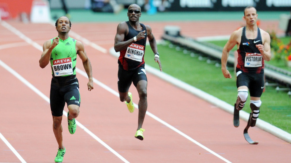 South African runner Oscar Pistorius, right, runs in the 400 meter race in France, July 8, 2011. His time in a race in Italy Tuesday was good enough to send him to the World Championships. (AFP/Getty Images)