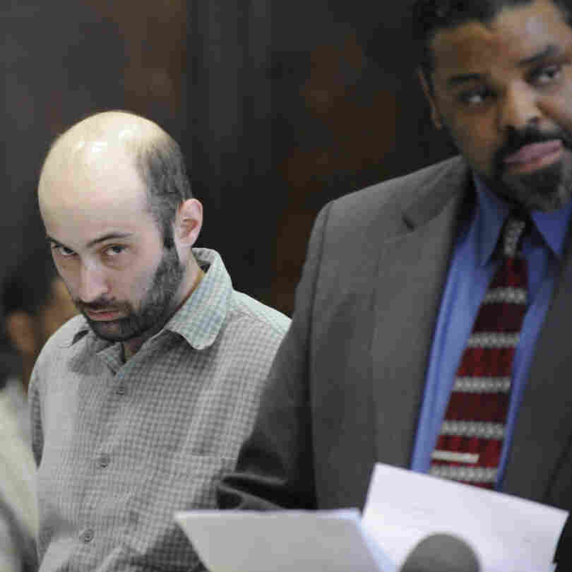 Levi Aron, left, is arraigned in Brooklyn criminal court Thursday, July 14, 2011, in New York. Aron, 35, is charged with luring 8-year-old Leiby Kletzky to his home on Monday, and then smothering him and chopping him up when he learned that a search was under way for the missing child. Detectives found the boy's feet in Aron's freezer.