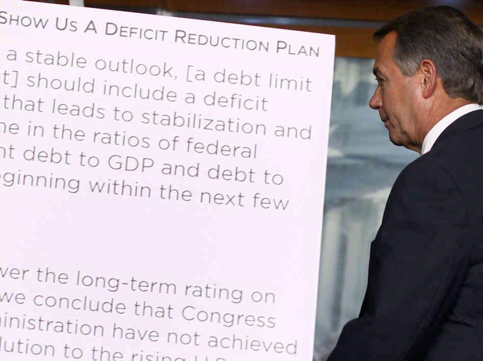 House Speaker John Boehner leaves a news U.S. Capitol news conference, July 19, 2011.