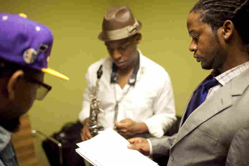 Ben Williams (right) confers with bandmates Marcus Strickland (center) and Jamire Williams backstage.